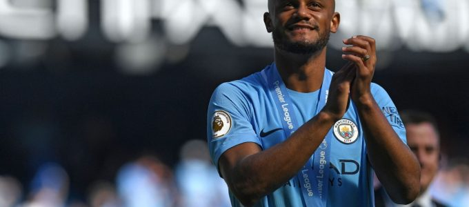 Manchester City's captain, Belgian defender Vincent Kompany takes a lap of honour after the English Premier League football match between Manchester City and Huddersfield Town at the Etihad Stadium in Manchester, north west England, on May 6, 2018. (Photo by Paul ELLIS / AFP) / RESTRICTED TO EDITORIAL USE. No use with unauthorized audio, video, data, fixture lists, club/league logos or 'live' services. Online in-match use limited to 75 images, no video emulation. No use in betting, games or single club/league/player publications. /         (Photo credit should read PAUL ELLIS/AFP/Getty Images)